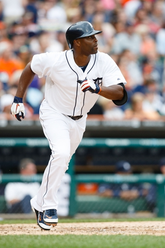 Sep 1, 2013; Detroit, MI, USA; Detroit Tigers right fielder Torii Hunter (48) runs to first against the Cleveland Indians at Comerica Park. Mandatory Credit: Rick Osentoski-USA TODAY Sports