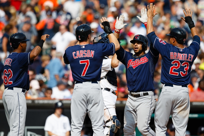 Sep 1, 2013; Detroit, MI, USA; Cleveland Indians third baseman Mike Aviles (4) receive congratulation from Matt Carson (7) left fielder Michael Brantley (23) and Jose Ramirez after he hit a grand slam home run during the ninth inning against the Detroit Tigers at Comerica Park. Mandatory Credit: Rick Osentoski-USA TODAY Sports