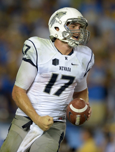 Aug 31, 2013; Pasadena, CA, USA; Nevada Wolf Pack quarterback Cody Fajardo (17) celebrates after scoring on a 19-yard touchdown run against the UCLA Bruins at the Rose Bowl. UCLA defeated Nevada 58-20. Mandatory Credit: Kirby Lee-USA TODAY Sports