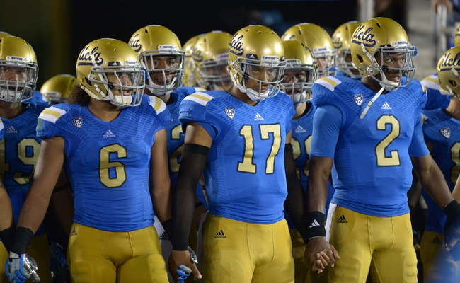 Aug 31, 2013; Pasadena, CA, USA; UCLA Bruins players Eric Kendricks (6), Brett Hundley (17) and Asiantii Woulard (2) hold hands during the game against the Nevada Wolf Pack at the Rose Bowl. UCLA defeated Nevada 58-20. Mandatory Credit: Kirby Lee-USA TODAY Sports