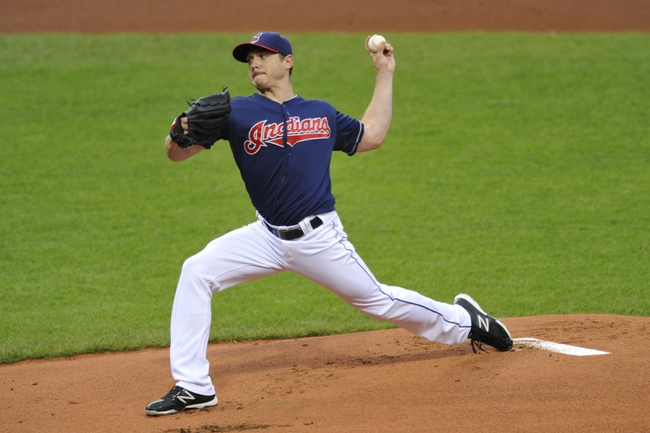 Sep 6, 2013; Cleveland, OH, USA; Cleveland Indians starting pitcher Scott Kazmir (26) delivers in the first inning against the New York Mets at Progressive Field. Mandatory Credit: David Richard-USA TODAY Sports