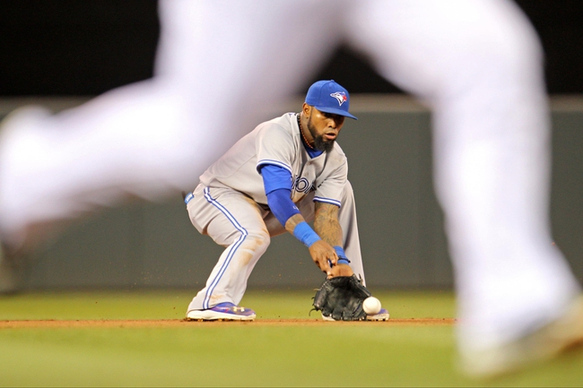 Sep 6, 2013; Minneapolis, MN, USA; Toronto Blue Jays shortstop Jose Reyes (7) fields a ground ball during the second inning against the Minnesota Twins at Target Field. Mandatory Credit: Brace Hemmelgarn-USA TODAY Sports