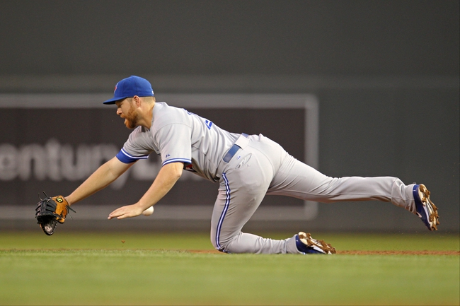 Sep 6, 2013; Minneapolis, MN, USA; Toronto Blue Jays first baseman Adam Ling (26) dives for a ball during the second inning against the Minnesota Twins at Target Field. Mandatory Credit: Brace Hemmelgarn-USA TODAY Sports