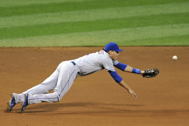 Sep 6, 2013; Cleveland, OH, USA; New York Mets third baseman Wilmer Flores (4) dives for an infield hit in the fifth inning against the Cleveland Indians at Progressive Field. Mandatory Credit: David Richard-USA TODAY Sports