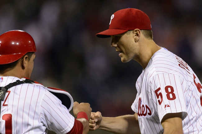 Sep 6, 2013; Philadelphia, PA, USA; Philadelphia Phillies pitcher Jonathan Papelbon (58) celebrates pitching the ninth inning with catcher Carlos Ruiz (51) against the Atlanta Braves at Citizens Bank Park. The Phillies defeated the Braves 2-1. Mandatory Credit: Howard Smith-USA TODAY Sports