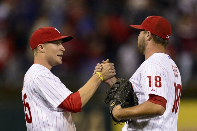 Sep 6, 2013; Philadelphia, PA, USA; Philadelphia Phillies third baseman Cody Asche (25) celebrates with first baseman Darin Ruf (18) after defeating the Atlanta Braves at Citizens Bank Park. The Phillies defeated the Braves 2-1. Mandatory Credit: Howard Smith-USA TODAY Sports