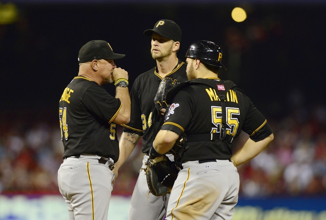 Sep 6, 2013; St. Louis, MO, USA; Pittsburgh Pirates starting pitcher A.J. Burnett (34) talks with pitching coach Ray Searage (54) and catcher Russell Martin (55) during the third inning against the St. Louis Cardinals at Busch Stadium. Mandatory Credit: Jeff Curry-USA TODAY Sports