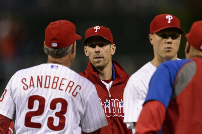 Sep 6, 2013; Philadelphia, PA, USA; Philadelphia Phillies pitcher Cliff Lee (33) celebrates with interim manager Ryne Sandberg (23) after defeating the Atlanta Braves at Citizens Bank Park. The Phillies defeated the Braves 2-1. Mandatory Credit: Howard Smith-USA TODAY Sports