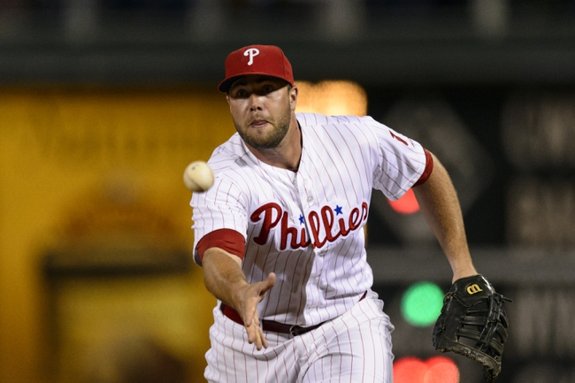 Sep 6, 2013; Philadelphia, PA, USA; Philadelphia Phillies first baseman Darin Ruf (18) tosses to the pitcher covering first base during the ninth inning against the Atlanta Braves at Citizens Bank Park. The Phillies defeated the Braves 2-1. Mandatory Credit: Howard Smith-USA TODAY Sports