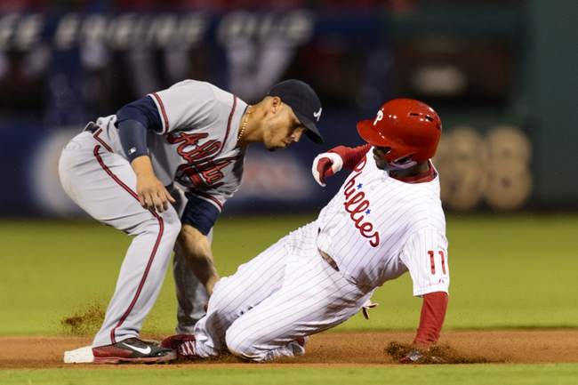 Sep 6, 2013; Philadelphia, PA, USA; Atlanta Braves shortstop Andrelton Simmons (19) tags out Philadelphia Phillies shortstop Jimmy Rollins (11) at second base after Rollins tried to stretch a single into a double during the fourth inning at Citizens Bank Park. The Phillies defeated the Braves 2-1. Mandatory Credit: Howard Smith-USA TODAY Sports
