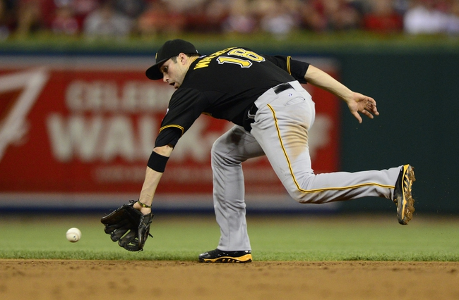 Sep 6, 2013; St. Louis, MO, USA; Pittsburgh Pirates second baseman Neil Walker (18) fields a throws out St. Louis Cardinals second baseman Daniel Descalso (not pictured) during the second inning at Busch Stadium. Mandatory Credit: Jeff Curry-USA TODAY Sports