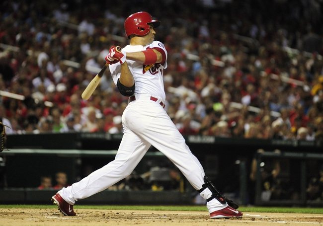 Sep 6, 2013; St. Louis, MO, USA; St. Louis Cardinals right fielder Carlos Beltran (3) hit s a two run single off of Pittsburgh Pirates starting pitcher A.J. Burnett (not pictured) during the first inning at Busch Stadium. Mandatory Credit: Jeff Curry-USA TODAY Sports
