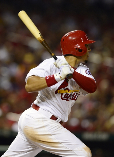 Sep 6, 2013; St. Louis, MO, USA; St. Louis Cardinals center fielder Jon Jay (19) hits a one run double off of Pittsburgh Pirates starting pitcher A.J. Burnett (not pictured) during the third inning at Busch Stadium. Mandatory Credit: Jeff Curry-USA TODAY Sports