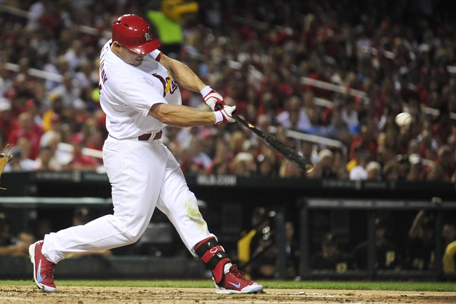 Sep 6, 2013; St. Louis, MO, USA; St. Louis Cardinals left fielder Matt Holliday (7) hits a one run double off of Pittsburgh Pirates starting pitcher A.J. Burnett (not pictured) during the third inning at Busch Stadium. Mandatory Credit: Jeff Curry-USA TODAY Sports