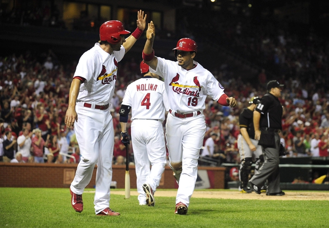 Sep 6, 2013; St. Louis, MO, USA; St. Louis Cardinals center fielder Jon Jay (19) celebrates with second baseman Matt Carpenter (13) after scoring on a single by right fielder Carlos Beltran (not pictured) during the first inning against the Pittsburgh Pirates at Busch Stadium. Mandatory Credit: Jeff Curry-USA TODAY Sports