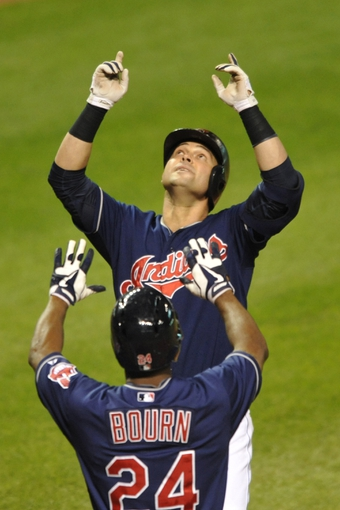 Sep 6, 2013; Cleveland, OH, USA; Cleveland Indians first baseman Nick Swisher (back) celebrates his grand slam home run in th