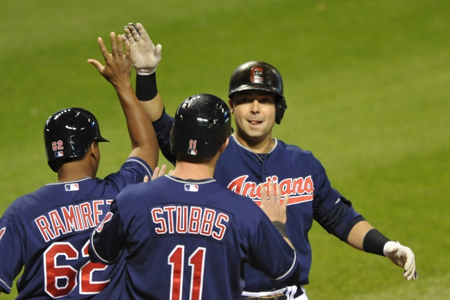 Sep 6, 2013; Cleveland, OH, USA; Cleveland Indians first baseman Nick Swisher (right) celebrates his grand slam home run in the eighth inning against the New York Mets at Progressive Field. Mandatory Credit: David Richard-USA TODAY Sports