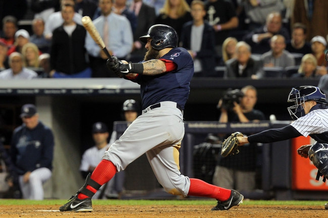 Sep 6, 2013; Bronx, NY, USA; Boston Red Sox first baseman Mike Napoli (12) hits a game-tying grand slam home run against the New York Yankees during the seventh inning of a game at Yankee Stadium. Mandatory Credit: Brad Penner-USA TODAY Sports