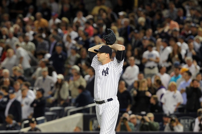 Sep 6, 2013; Bronx, NY, USA; New York Yankees relief pitcher Boone Logan (48) reacts after allowing a game-tying grand slam home run to Boston Red Sox first baseman Mike Napoli (not pictured) during the seventh inning of a game at Yankee Stadium. Mandatory Credit: Brad Penner-USA TODAY Sports