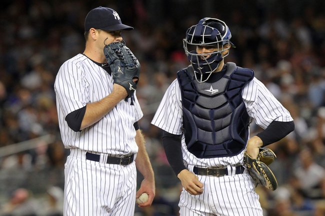 Sep 6, 2013; Bronx, NY, USA; New York Yankees relief pitcher Boone Logan (48) talks with New York Yankees catcher Chris Stewart (19) during the seventh inning of a game against the Boston Red Sox at Yankee Stadium. Mandatory Credit: Brad Penner-USA TODAY Sports
