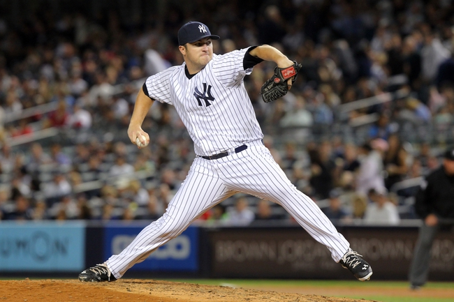 Sep 6, 2013; Bronx, NY, USA; New York Yankees relief pitcher Phil Hughes (65) pitches during the seventh inning of a game against the Boston Red Sox at Yankee Stadium. Mandatory Credit: Brad Penner-USA TODAY Sports