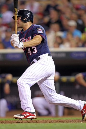Sep 6, 2013; Minneapolis, MN, USA; Minnesota Twins catcher Josmil Pinto (43) hits a single during the fifth inning against the Toronto Blue Jays at Target Field. Mandatory Credit: Brace Hemmelgarn-USA TODAY Sports