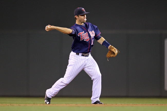 Sep 6, 2013; Minneapolis, MN, USA; Minnesota Twins shortstop Brian Dozier (2) throws to first base during the sixth inning against the Toronto Blue Jays at Target Field. Mandatory Credit: Brace Hemmelgarn-USA TODAY Sports