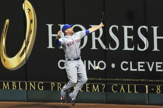 Sep 6, 2013; Cleveland, OH, USA; New York Mets right fielder Andrew Brown (47) reaches for a double by Cleveland Indians third baseman Lonnie Chisenhall (not pictured) in the sixth inning at Progressive Field. Mandatory Credit: David Richard-USA TODAY Sports