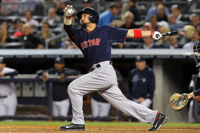Sep 6, 2013; Bronx, NY, USA; Boston Red Sox center fielder Shane Victorino (18) hits a two-run home run against the New York Yankees during the eighth inning of a game at Yankee Stadium. Mandatory Credit: Brad Penner-USA TODAY Sports