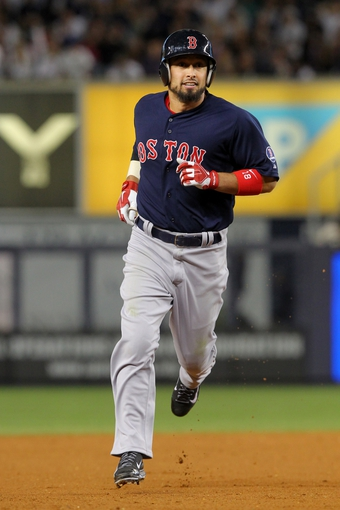 Sep 6, 2013; Bronx, NY, USA; Boston Red Sox center fielder Shane Victorino (18) rounds the bases after hitting a two-run home run against the New York Yankees during the eighth inning of a game at Yankee Stadium. Mandatory Credit: Brad Penner-USA TODAY Sports