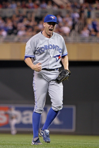 Sep 6, 2013; Minneapolis, MN, USA; Toronto Blue Jays pitcher Casey Janssen (44) celebrates following the game against the Minnesota Twins at Target Field. The Blue Jays defeated the Twins 6-5. Mandatory Credit: Brace Hemmelgarn-USA TODAY Sports