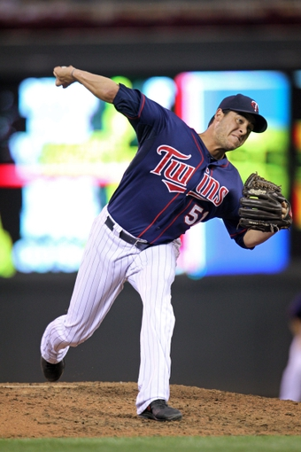 Sep 6, 2013; Minneapolis, MN, USA; Minnesota Twins pitcher Anthony Swarzak (51) delivers a pitch during the eighth inning against the Toronto Blue Jays at Target Field. The Blue Jays defeated the Twins 6-5. Mandatory Credit: Brace Hemmelgarn-USA TODAY Sports