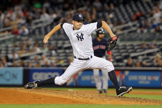 Sep 6, 2013; Bronx, NY, USA; New York Yankees relief pitcher Matt Daley (40) makes his major league debut during the ninth inning of a game against the Boston Red Sox at Yankee Stadium. Mandatory Credit: Brad Penner-USA TODAY Sports