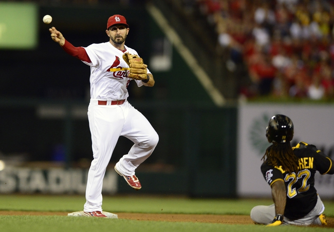 Sep 6, 2013; St. Louis, MO, USA; St. Louis Cardinals second baseman Daniel Descalso (33) turns a double play as Pittsburgh Pirates center fielder Andrew McCutchen (22) slides during the third inning at Busch Stadium. Mandatory Credit: Jeff Curry-USA TODAY Sports
