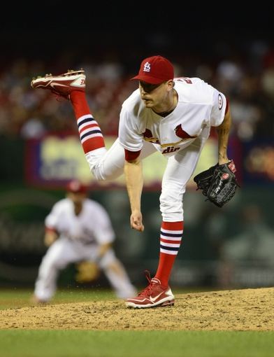 Sep 6, 2013; St. Louis, MO, USA; St. Louis Cardinals relief pitcher John Axford (34) throws to a Pittsburgh Pirates batter during the eighth inning at Busch Stadium. Mandatory Credit: Jeff Curry-USA TODAY Sports