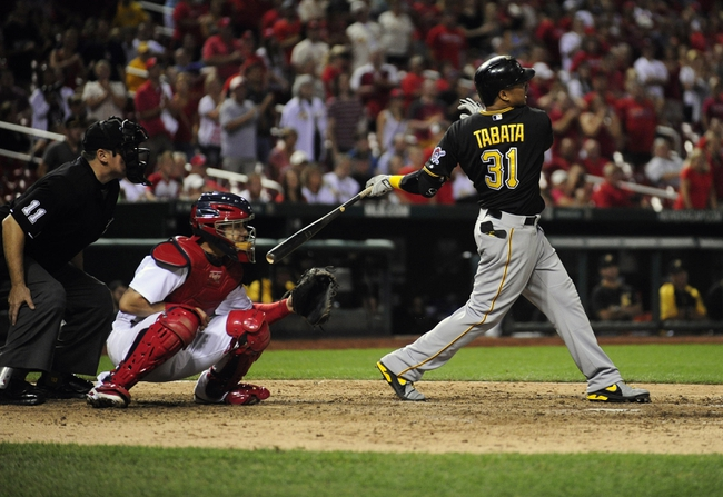 Sep 6, 2013; St. Louis, MO, USA; Pittsburgh Pirates right fielder Jose Tabata (31) hits a two run double off of St. Louis Cardinals relief pitcher Carlos Martinez (not pictured) during the ninth inning at Busch Stadium. St. Louis defeated Pittsburgh 12-8. Mandatory Credit: Jeff Curry-USA TODAY Sports