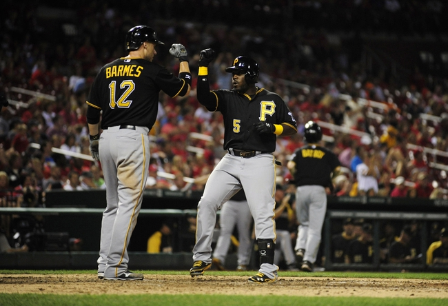Sep 6, 2013; St. Louis, MO, USA; Pittsburgh Pirates third baseman Josh Harrison (5)  celebrates with shortstop Clint Barmes (12) after hitting a two run home run off of St. Louis Cardinals relief pitcher Jake Westbrook (not pictured) during the eighth inning at Busch Stadium. St. Louis defeated Pittsburgh 12-8. Mandatory Credit: Jeff Curry-USA TODAY Sports