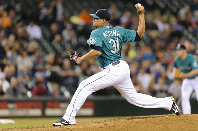Sep 6, 2013; Seattle, WA, USA; Seattle Mariners relief pitcher Yoervis Medina (31) pitches to the Tampa Bay Rays during the 6th inning at Safeco Field. Mandatory Credit: Steven Bisig-USA TODAY Sports