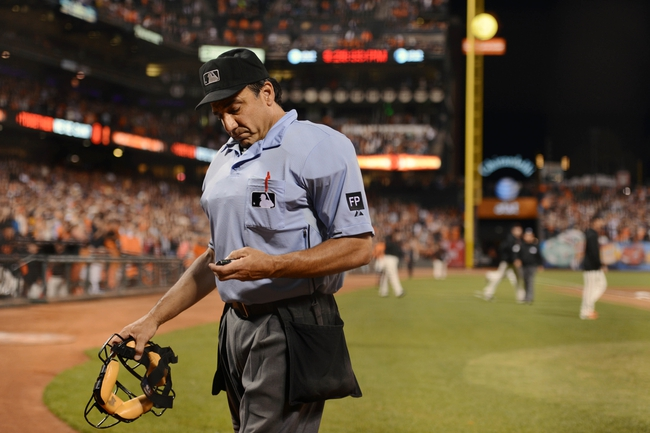 September 6, 2013; San Francisco, CA, USA; MLB umpire Phil Cuzzi (10) leaves the field after the game between the San Francisco Giants and the Arizona Diamondbacks at AT&T Park. The Giants defeated the Diamondbacks 3-0. Mandatory Credit: Kyle Terada-USA TODAY Sports