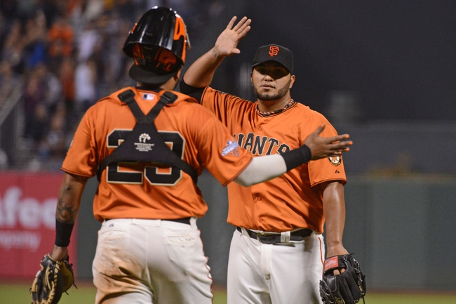 September 6, 2013; San Francisco, CA, USA; San Francisco Giants starting pitcher Yusmeiro Petit (52, right) celebrates with catcher Hector Sanchez (29, left) after the game against the Arizona Diamondbacks at AT&T Park. The Giants defeated the Diamondbacks 3-0. Mandatory Credit: Kyle Terada-USA TODAY Sports