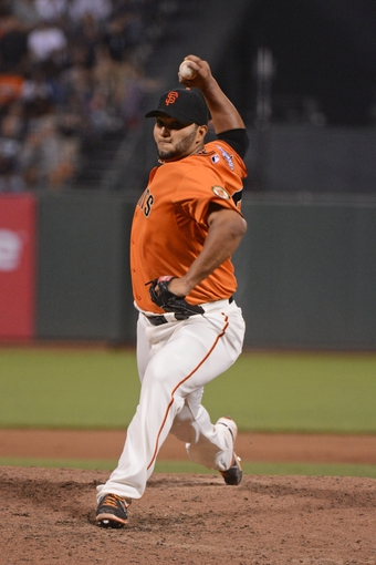 September 6, 2013; San Francisco, CA, USA; San Francisco Giants starting pitcher Yusmeiro Petit (52) delivers a pitch against the Arizona Diamondbacks during the ninth inning at AT&T Park. The Giants defeated the Diamondbacks 3-0. Mandatory Credit: Kyle Terada-USA TODAY Sports