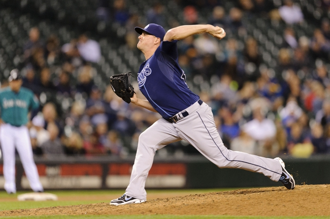 Sep 6, 2013; Seattle, WA, USA; Tampa Bay Rays relief pitcher Jake McGee (57) pitches to the Seattle Mariners during the 7th inning at Safeco Field. Mandatory Credit: Steven Bisig-USA TODAY Sports