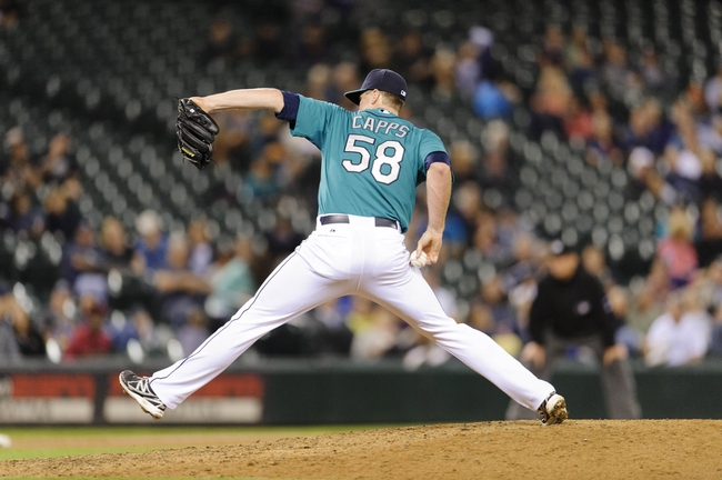 Sep 6, 2013; Seattle, WA, USA; Seattle Mariners relief pitcher Carter Capps (58) pitches to the Tampa Bay Rays during the 8th inning at Safeco Field. Seattle defeated Tampa Bay 6-4. Mandatory Credit: Steven Bisig-USA TODAY Sports