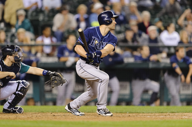 Sep 6, 2013; Seattle, WA, USA; Tampa Bay Rays pinch hitter Luke Scott (30) hits a RBI double against the Seattle Mariners during the 8th inning at Safeco Field. Seattle defeated Tampa Bay 6-4. Mandatory Credit: Steven Bisig-USA TODAY Sports