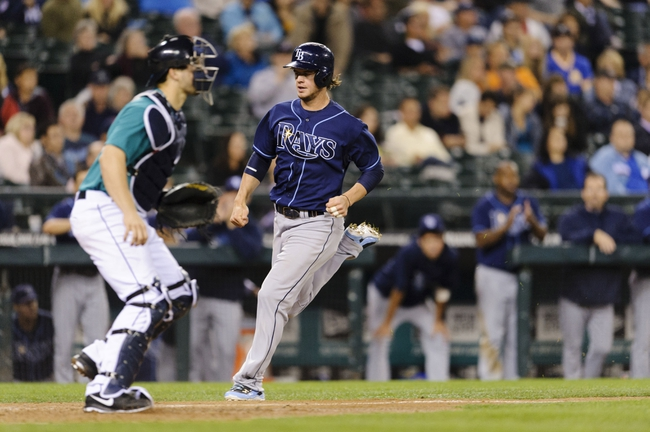 Sep 6, 2013; Seattle, WA, USA; Tampa Bay Rays right fielder Wil Myers (9) scores a run off a RBI double hit by Tampa Bay Rays pinch hitter Luke Scott (30) during the 8th inning against the Seattle Mariners at Safeco Field. Seattle defeated Tampa Bay 6-4. Mandatory Credit: Steven Bisig-USA TODAY Sports