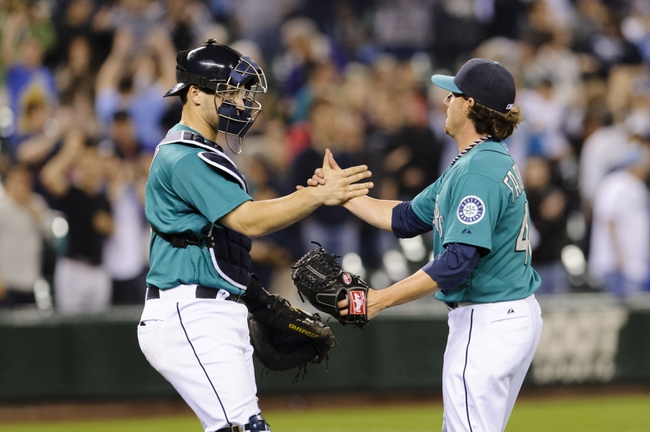 Sep 6, 2013; Seattle, WA, USA; Seattle Mariners catcher Mike Zunino (3) and Seattle Mariners relief pitcher Danny Farquhar (40) celebrate after defeating Tampa Bay at the end of the 9th inning at Safeco Field. Seattle defeated Tampa Bay 6-4. Mandatory Credit: Steven Bisig-USA TODAY Sports