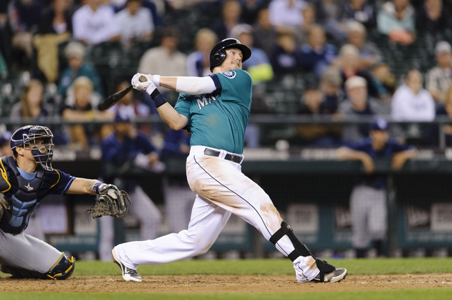 Sep 6, 2013; Seattle, WA, USA; Seattle Mariners first baseman Justin Smoak (17) hits a 2-RBI double against the Tampa Bay Rays during the 8th inning at Safeco Field. Seattle defeated Tampa Bay 6-4. Mandatory Credit: Steven Bisig-USA TODAY Sports