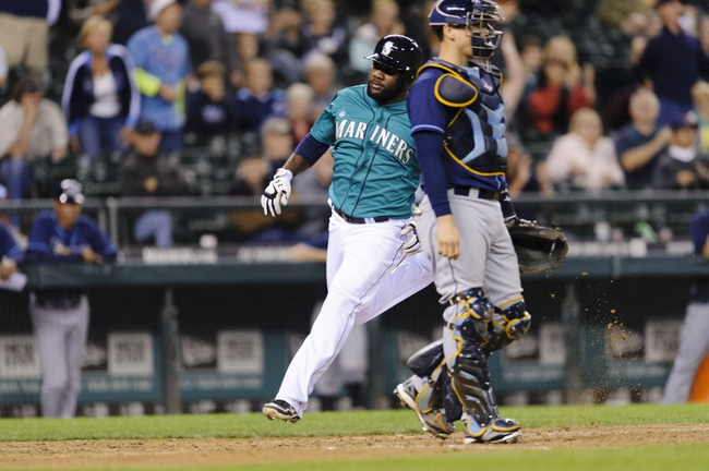 Sep 6, 2013; Seattle, WA, USA; Seattle Mariners pinch runner Abraham Almonte (36) scores a run against the Tampa Bay Rays off a 2-RBI double hit by Seattle Mariners first baseman Justin Smoak (17) (not pictured) during the 8th inning at Safeco Field. Seattle defeated Tampa Bay 6-4. Mandatory Credit: Steven Bisig-USA TODAY Sports