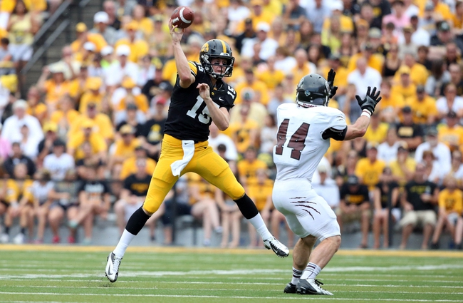 Sep 7, 2013; Iowa City, IA, USA; University of Iowa quarterback Jake Rudock (15) throws a pass against the defense of Missouri State Bears linebacker Nick Canavan (44) in the first quarter at Kinnick Stadium.  Mandatory Credit: Reese Strickland-USA TODAY Sports