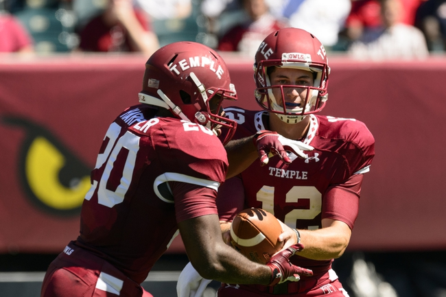 Sep 7, 2013; Philadelphia, PA, USA; Temple Owls quarterback Connor Reilly (12) hands off to running back Kenneth Harper (20) during the first quarter against the Houston Cougars at Lincoln Financial Field. Mandatory Credit: Howard Smith-USA TODAY Sports